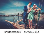 stylish wealthy couple on a... | Shutterstock . vector #609382115