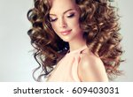 brunette  girl with long  and ... | Shutterstock . vector #609403031