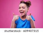 studio shot of emotional... | Shutterstock . vector #609407315