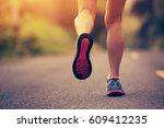 young fitness woman runner legs ... | Shutterstock . vector #609412235