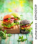 red  green black mini burgers... | Shutterstock . vector #609420539