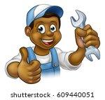 a black handyman mechanic or... | Shutterstock . vector #609440051