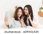 young asian girls doing selfie... | Shutterstock . vector #609441434