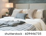 dark gray sweater on bed with... | Shutterstock . vector #609446735