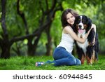 Stock photo young girl with a dog in the park 60944845