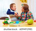 group of kids playing together... | Shutterstock . vector #609491981