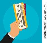 hand holding boarding pass...   Shutterstock .eps vector #609504374
