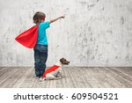 little superhero with dog in... | Shutterstock . vector #609504521