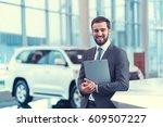 smiling man in suit indoors | Shutterstock . vector #609507227