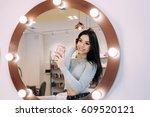 woman makes selfie in makeup... | Shutterstock . vector #609520121