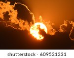 sun with clouds on fiery... | Shutterstock . vector #609521231