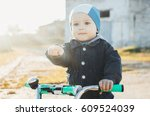 child on a bike  in the spring... | Shutterstock . vector #609524039