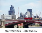 View of Blackfriars bridge with red bus and the city in background - stock photo
