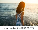 back view silhouette of...   Shutterstock . vector #609565379