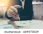 a business man with an open... | Shutterstock . vector #609573029