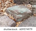 Large Rock In The Ground With...