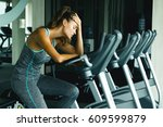 woman on the stationary bike... | Shutterstock . vector #609599879