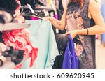 woman buying clothes at the... | Shutterstock . vector #609620945