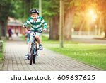 child on a bicycle at asphalt... | Shutterstock . vector #609637625