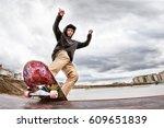 Teen Skater In A Hoodie...