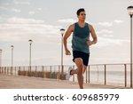 shot of fit young man running... | Shutterstock . vector #609685979