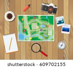 wooden table with paper map.... | Shutterstock .eps vector #609702155