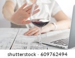 woman refuses to drink a wine | Shutterstock . vector #609762494