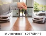 man giving keys to someone... | Shutterstock . vector #609768449