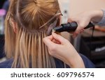 the hairdresser does hair... | Shutterstock . vector #609796574