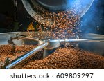 mixing roasted coffee | Shutterstock . vector #609809297