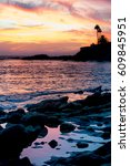 Sunset At A Rocky Beach In...