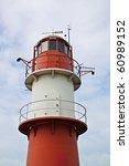 red lighthouse in warnemuende ... | Shutterstock . vector #60989152