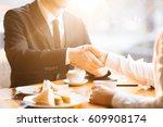 handshake of businessmen during ... | Shutterstock . vector #609908174