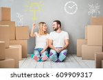 happy couple at new home. man... | Shutterstock . vector #609909317