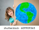 happy child painting the... | Shutterstock . vector #609909365