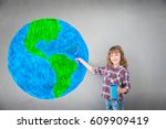 Happy Child Painting Planet On...
