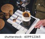 hand drip coffee barista... | Shutterstock . vector #609912365