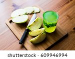 appletini   green apple juice.... | Shutterstock . vector #609946994