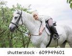 little girls embracing a horse.   Shutterstock . vector #609949601