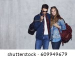 Smiling Couple In Denim And...