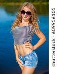 female having fun on the beach. ...   Shutterstock . vector #609956105