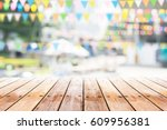 empty wooden table with party...   Shutterstock . vector #609956381
