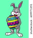 cartoon easter bunny carrying a ...   Shutterstock .eps vector #609971351