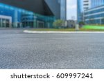 empty pavement and modern... | Shutterstock . vector #609997241