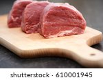 tasty raw veal or beef meat on... | Shutterstock . vector #610001945
