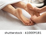 young woman receiving foot... | Shutterstock . vector #610009181