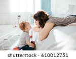 the mother admiring at her son | Shutterstock . vector #610012751