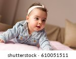 beautiful baby girl crawling... | Shutterstock . vector #610051511