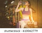 fitness woman drinking water... | Shutterstock . vector #610062779