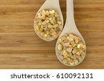 wooden spoon of aromatic yellow ... | Shutterstock . vector #610092131
